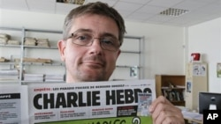 Majalah mingguan satiris Prancis Charlie Hebdo dalam penerbitannya hari Rabu (19 September 2012) memuat karikatur-karikatur tentang Nabi Muhammad (foto, 19/9/2012).,