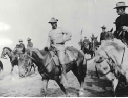Theodore Roosevelt, center, with the Rough Riders at San Juan Hill, Cuba, 1898