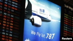 An electronic board displaying flight schedule and advertising of All Nippon Airways Boeing Co's 787 plane is seen at New Tokyo international airport in Narita, east of Tokyo, Jan. 9, 2013.