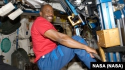 In this Nov. 22, 2009 photo made available by NASA, astronaut Leland Melvin, STS-129 mission specialist, exercises in the Unity module of the International Space Station while the space shuttle Atlantis is docked with the station
