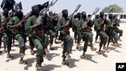 FILE - Hundreds of newly trained al-Shabab fighters perform military exercises in the Lafofe area, south of Mogadishu, Somalia, Feb. 17, 2017.