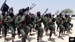 FILE - Hundreds of newly trained al-Shabab fighters perform military exercises in the Lafofe area 18 km south of Mogadishu, Somalia, Feb. 17, 2017. Tuesday's U.S. drone strike reportedly targeted an al-Shabab training camp in Somalia's Bay region.