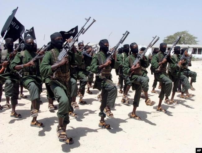 FILE - Hundreds of newly trained al-Shabab fighters perform military exercises in the Lafofe area 18 km south of Mogadishu, Somalia, Feb. 17, 2017.