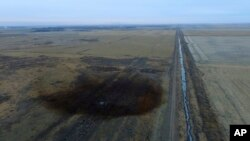 FILE - This aerial photo shows a spill from TransCanada Corp.'s Keystone pipeline, Nov. 17, 2017, near Amherst, S.D. The spill, originally estimated at 210,000 gallons of oil, is now deemed to have been about 407,000 gallons.