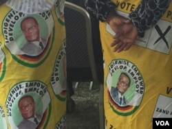 Some of the people in Zvimba communal lands wearing clothes with photos of the late Robert Mugabe.