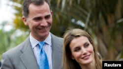 "FILE - Spain's Crown Prince Felipe and Princess Letizia smile as they attend the inauguration of the ""Palmetum"" botanic park in Santa Cruz de Tenerife, on the Spanish Canary Island of Tenerife, Jan. 28, 2014."