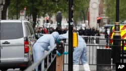 Police forensic officers attend the scene after a person was arrested following an incident in Whitehall in London, April 27, 2017.