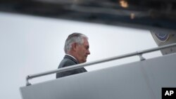 FILE - U.S. Secretary of State Rex Tillerson boards his plane at Cologne Bonn Airport, Germany, as he leaves after a meeting of foreign ministers of the G-20 leading and developing economies, Feb. 17, 2017. On Wednesday, Tillerson and U.S. Homeland Security Secretary John Kelly will visit Mexico.