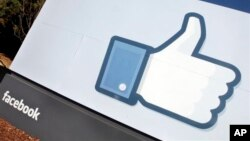 """FILE - The Facebook """"Like"""" icon displayed outside of company headquarters, Menlo Park, California, Jan. 2012."""