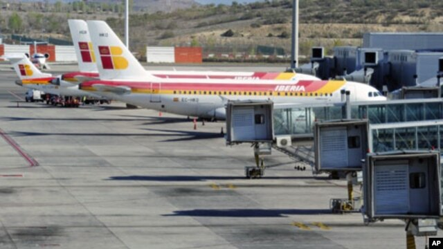 Planes of Spanish airline Iberia are parked at the Madrid's Barajas airport, at the start of a series of one-day strike by Iberia pilots, April 9, 2012.