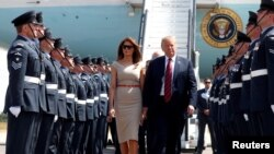 President Donald Trump and first lady Melania Trump arrive at Stansted Airport, Britain, July 12 2018.
