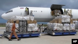 FILE - Freight is being offloaded from a plane at Mogadishu airport, in Mogadishu, Somalia, Aug. 8, 2011.