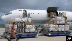 FILE - Freight is being offloaded from a plane at Mogadishu airport, in Mogadishu, Somalia, Aug. 8, 2011. Somalia is embroiled in a standoff over the confiscation from UAE diplomats at Mogadishu airport of nearly $10 million in cash whose purpose remains in dispute.