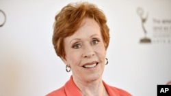 FILE - Actress and comedian Carol Burnett arrives at the Academy of Television Arts and Sciences' An Evening with Carol Burnett at the Leonard H. Goldenson Theatre in Los Angeles, July 22, 2013.