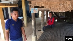 Migrant workers Min Sarun and Neang Chantrea are worried about repaying their loan after returning to Cambodia to no jobs, as they remained isolated in Bati district, Takeo province, Cambodia, April 7, 2020. (Ananth Baliga/VOA Khmer)