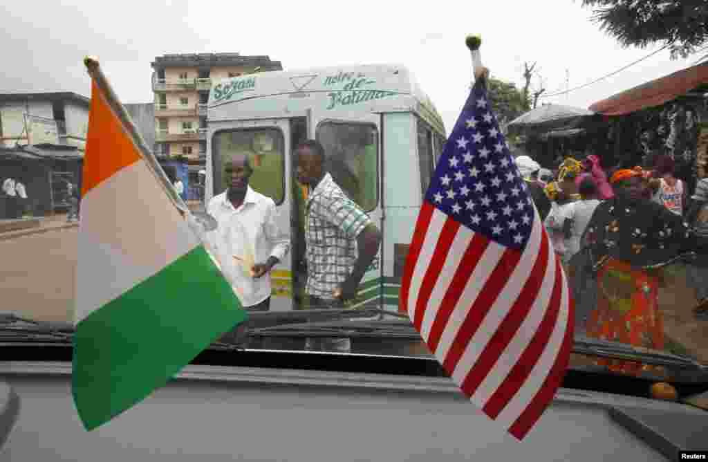 The U.S. and Ivory Coast national flags are displayed in a public bus station station, in Abidjan, Ivory Coast, Aug. 3, 2014.