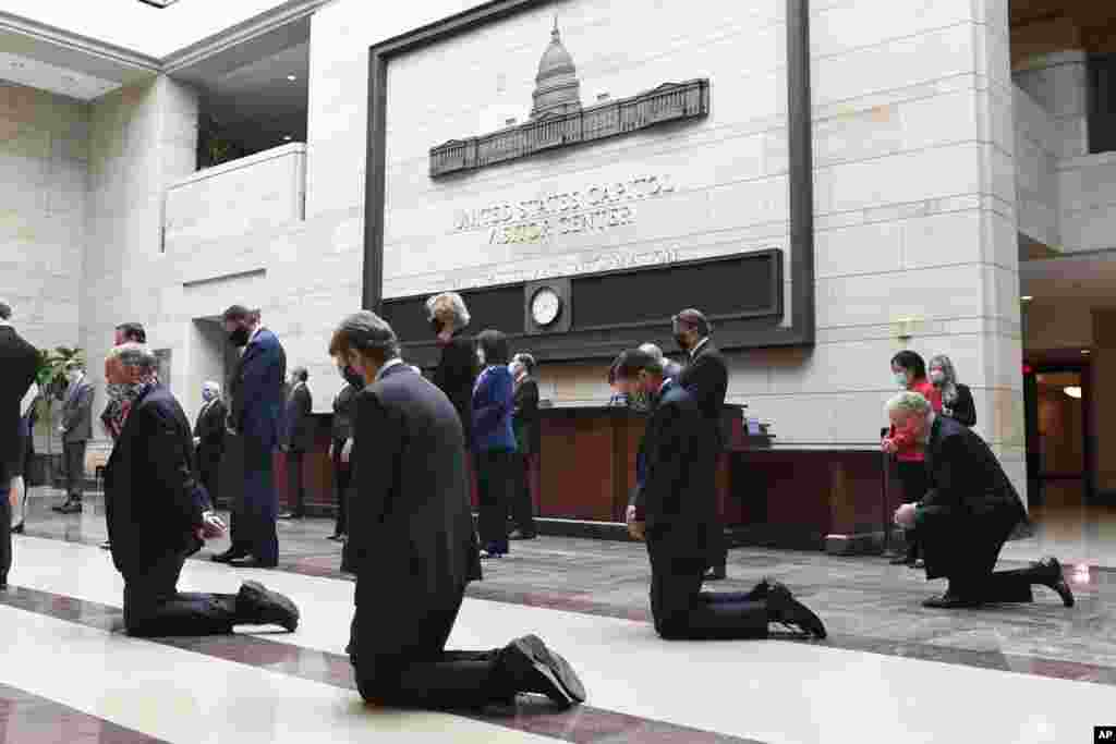 Democratic Senators pause for 8 minutes and 46 seconds on Capitol Hill in Washington, Thursday, June 4, 2020, to remember the life of George Floyd, a black man who died after being restrained by Minneapolis police officers. (AP Photo/Susan Walsh)