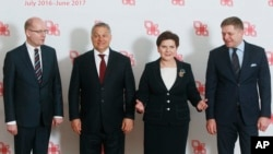 Prime ministers of the Visegrad group countries, from left, Czech Republic's Prime Minister Bohuslav Sobotka, Hungarian Prime Minister Viktor Orban, Polish Prime Minister Beata Szydlo and Slovakian Prime Minister Robert Fico pose for media before their meeting in Warsaw, Poland, Tuesday, March 28, 2017.