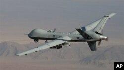美國無人駕駛飛機在阿富汗南部上空巡邏。