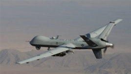 FILE - A Reaper drone patrols the skies in southern Afghanistan near the frontier with Pakistan.