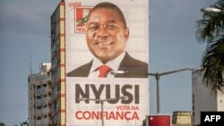 A giant Mozambican Liberation Front (FRELIMO) billboard hangs from a building in Avenida Edoardo Modlande on the eve of Mozambican Presidential and Legislative elections on October 14, 2014 in Maputo.