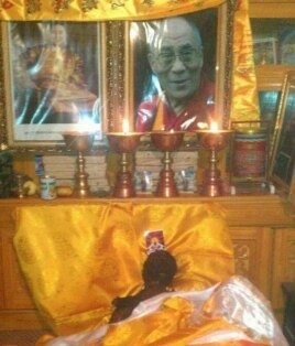 Wangchen Norbu's body covered with scarves