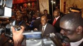 Zimbabwean President Robert Mugabe (C) briefs journalists after meeting with Prime Minister Morgan Tsvangirai and South African President Jacob Zuma on the progress made on the implementation of The Global Political Agreement ahead of anticipated election
