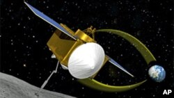 An artist's conception of the OSIRIS-REx spacecraft collecting a sample from asteroid 1999 RQ36 (aka: Bennu)