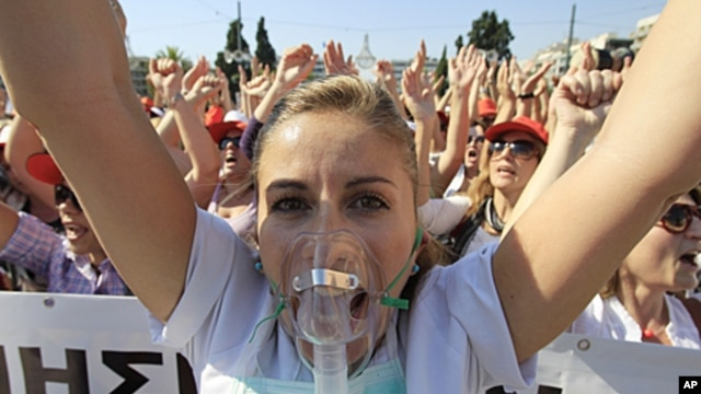 A nurse shouts slogans during a protest by hospital staff in Athens, October 13, 2011.