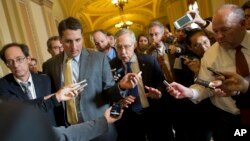 Senate Majority Leader Sen. Harry Reid, D-Nev., is surrounded by reporters after leaving the office of Senate Minority Leader Sen. Mitch McConnell, R-Ken., on Capitol Hill on Oct. 14, 2013.