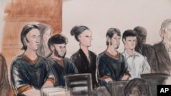 FILE - A courtroom sketch portrays four men accused of plotting to send US residents overseas to fight for the Islamic State: Akhror Saidakhmetov (L), Abror Habibov, (2nd-L), Abdurasul Hasanovich Juraboev (4th-L) and Dilkhayot Kasimov (5th-L), appear in a New York City courtroom, April 8, 2015.