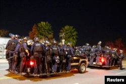 Police follow protesters during a march in Los Angeles, California, following Monday's grand jury decision in the shooting of Michael Brown in Ferguson, Missouri, November 25, 2014.