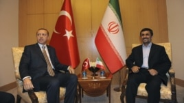 Iran's President Mahmoud Ahmadinejad (R) meets with Turkey's Prime Minister Recep Tayyip Erdogan in Istanbul, May 9, 2011.