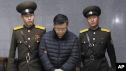 Hyeon Soo Lim, the pastor of the Light Korean Presbyterian Church in Toronto, Canada, is brought to court in Pyongyang, North Korea, Wednesday, Dec. 16, 2015. North Korea's Supreme Court sentenced him to life in prison with hard labor.
