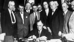 "President Franklin Roosevelt signs a law creating the Tennessee Valley Authority on May 18, 1933. He envisioned ""a corporation clothed with the power of government but possessed of the flexibility and initiative of private enterprise."""
