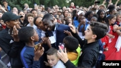France's defender Benjamin Mendy is congratulated by supporters during a reception at the Elysee Presidential Palace after they won the Russia 2018 World Cup final football match, in Paris, France, July 16, 2018.