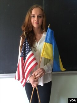 Xenia Vitovych, who was born in Ukraine, takes fierce pride in her homelands, both new and old. She volunteers for the Patriot Defense, which helps the Ukrainian army with funds and supplies, New York, Sept. 10, 2014 (Adam Phillips/VOA).