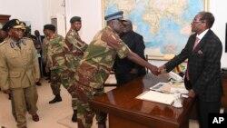 Umongameli Robert Mugabe lenkokheli yebutho.