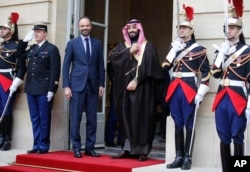 FILE - Saudi Arabia Crown Prince Mohammed bin Salman, center, is welcomed by French Prime Minister Edouard Philippe, second left, in Paris, April 9, 2018.