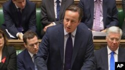 British Prime Minister David Cameron talks to lawmakers in the House of Commons in London during a debate on launching airstrikes against Islamic State extremists inside Syria, Dec. 2, 2015. The parliamentary vote is expected Wednesday evening.