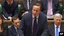PM Inggris David Cameron saat menyampaikan pidato di hadapan anggota parlemen Inggris di London (2/12).