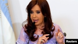 FILE - Argentina's President Cristina Fernandez de Kirchner speaks after a meeting with governors in the Casa Rosada government house in Buenos Aires, Jan. 30, 2015.