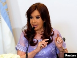 FILE - Argentina's President Cristina Fernandez de Kirchner speaks after heading a meeting with governors in Casa Rosada government house in Buenos Aires, Jan. 30, 2015.