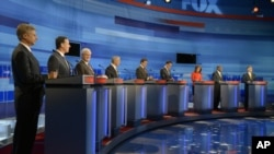 Republican presidential candidates from left, former New Mexico Governor Gary Johnson, former Pennsylvania Senator Rick Santorum, former House Speaker Newt Gingrich, Rep. Ron Paul, Texas Gov. Rick Perry, former Massachusetts Governor Mitt Romney, Rep. Mic