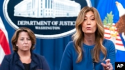 FILE - Anne Milgram, administrator of the Drug Enforcement Administration, right, speaks accompanied by Deputy Attorney General Lisa Monaco, during a news conference at the Department of Justice, Sept. 30, 2021, in Washington.