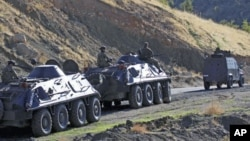 FILE - Turkish soldiers in armored vehicles patrol in Sirnak province on the Turkish-Iraqi border, October 21, 2011.