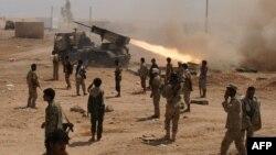 Yemeni soldiers stand near a rocket launching during a major offensive against al-Qaida in the Arabian Peninsula (AQAP) in the Maifaa region of Shabwa province, May 4, 2014.