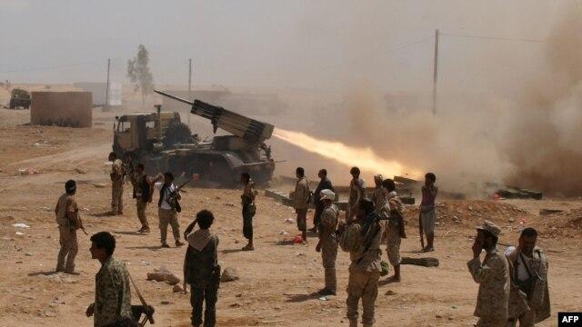 FILE - Yemeni soldiers stand near a rocket launching during a major offensive against al-Qaida in the Arabian Peninsula (AQAP) in the Maifaa region of Shabwa province, May 4, 2014.