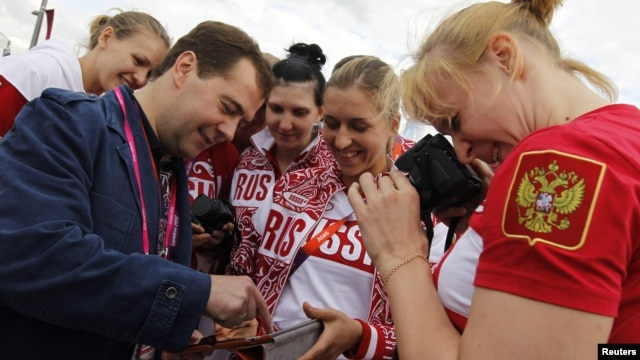 Russia's Prime Minister Dmitry Medvedev meets with members of the Russian Olympic team in London this summer. He recently called for a ban on smoking.