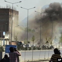 Smoke rises from the site of an attack near the Afghan parliament in Kabul, April 15, 2012.